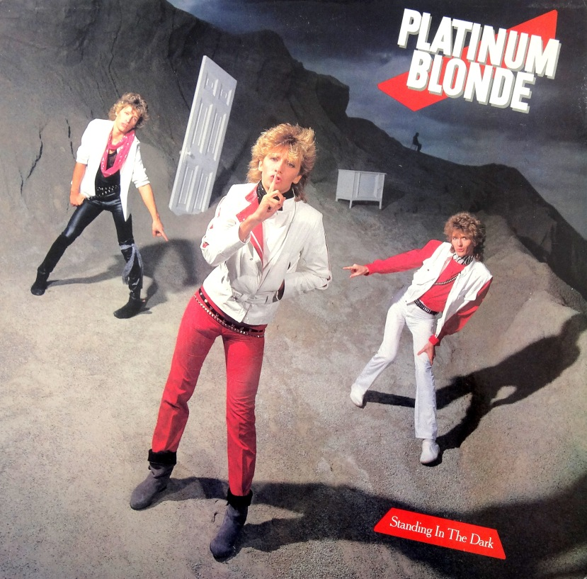 platinum blonde standing in the dark front