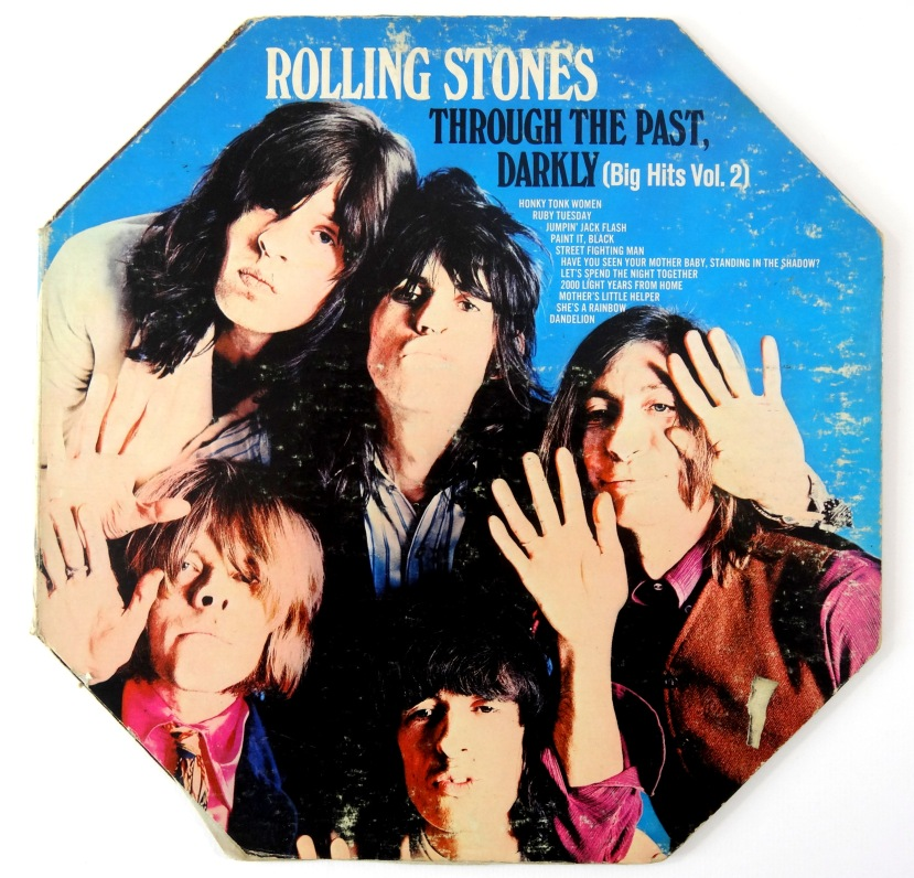 rolling stones through the glass darkly front