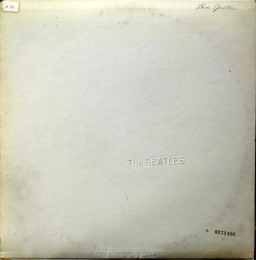 From the stacks the beatles white album with inserts for Love is a four letter word album cover